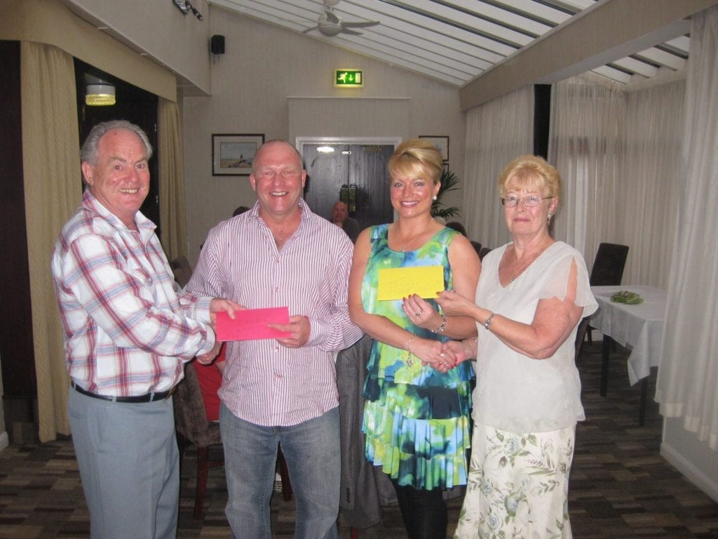 John and Lilian Lightfoot present Carl Johnson and Julie Lightfoot with their long service award