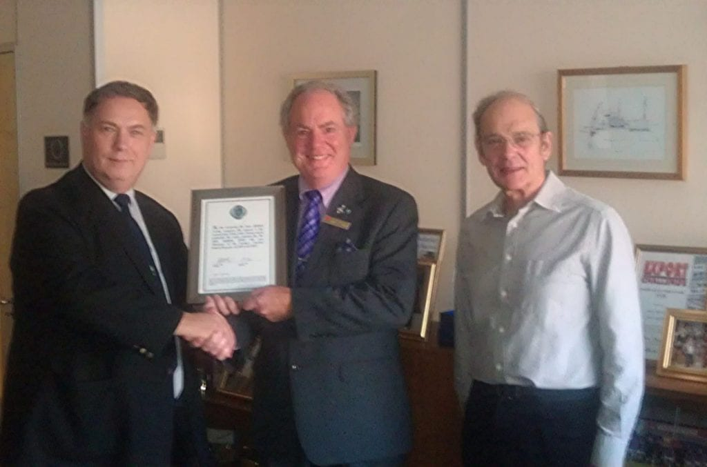 Stephen Healy, chairman of the Tyne Lifeboat Society and secretary Dr. Chris May present John Lightfoot, chairman of Solar Solve Ltd. with a commemorative citation in recognition of the support given to the Society by John and his company.