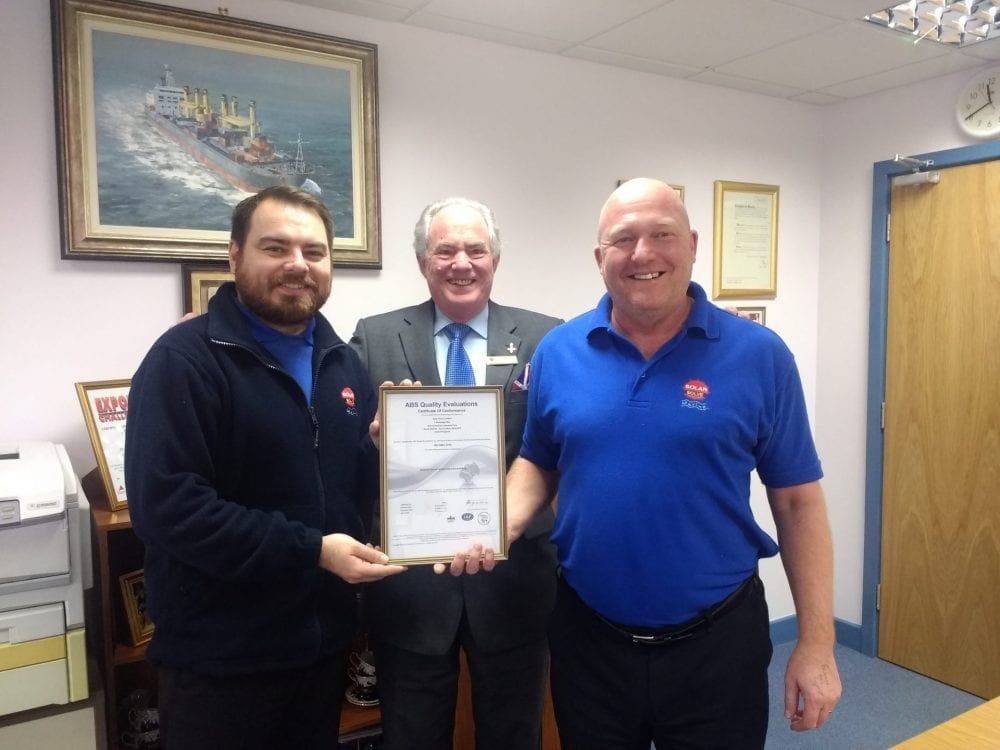 Photo of the ISO 9001:2015 Quality Certificate being presented