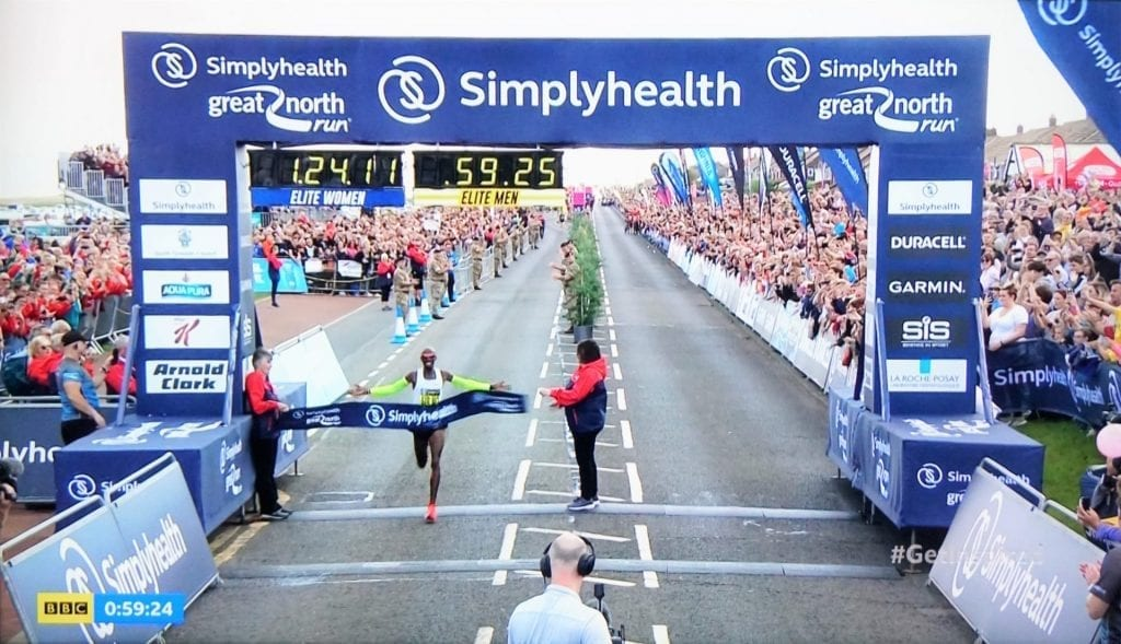 Sir Mo Farah winning the men's Elite race for a record fifth year in a row,