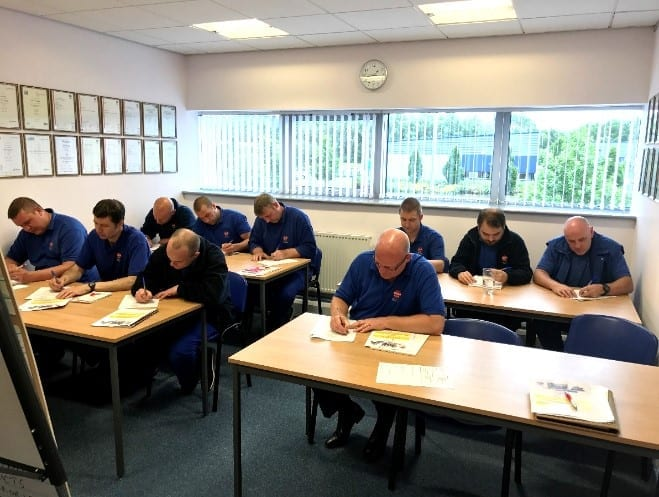 Some of Solar Solve's employees deep in thought at a training session in the dedicated Training Room at the South Shields Headquarters